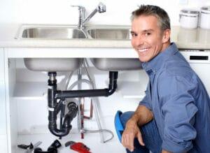 lyndhurst nj plumber works on a broken sink