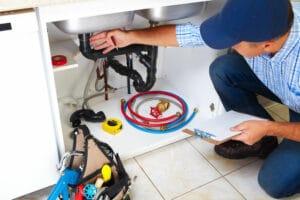 a plumber working on plumbing in wycoff