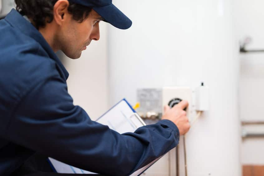 a plumber working on heating service in bergen county nj