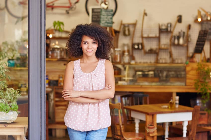 young female business owner in store after commercial heating repairs