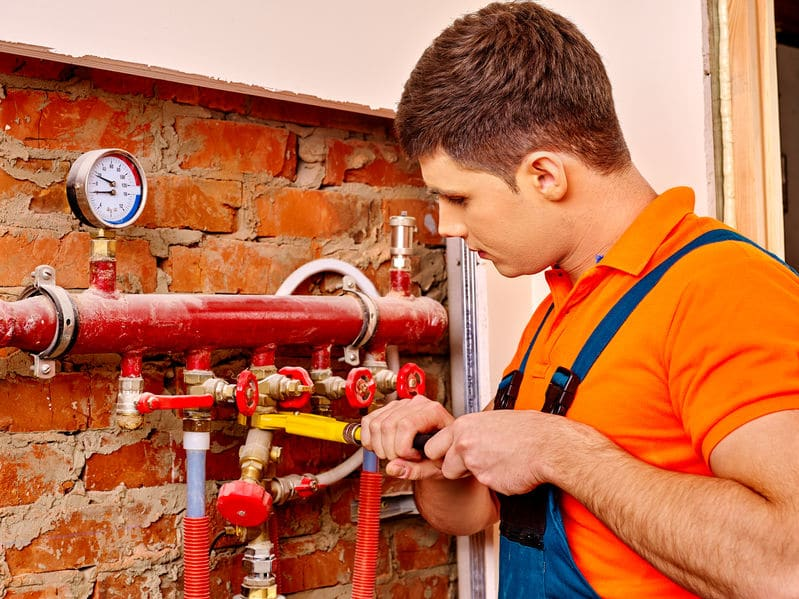 image of a man prefeorming commercial heating services