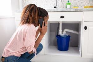 Image of woman calling for bathroom plumbing repairs in bergen county nj