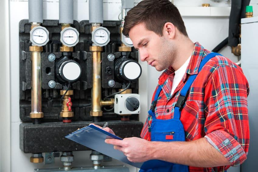 man performing boiler repair in Englewood NJ