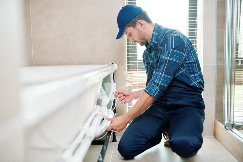 plumber performing drain and sewer line replacement